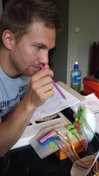 Skjalg using the model to study the cranial nerves