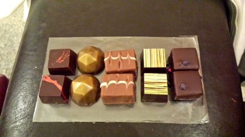 Chocolate flight from last Friday's date night. Picked up some specialty chocolates from the local chocolatier. Sour apple, coconut marzipan, strawberry and chili, violet and a last one that I can't remember.
