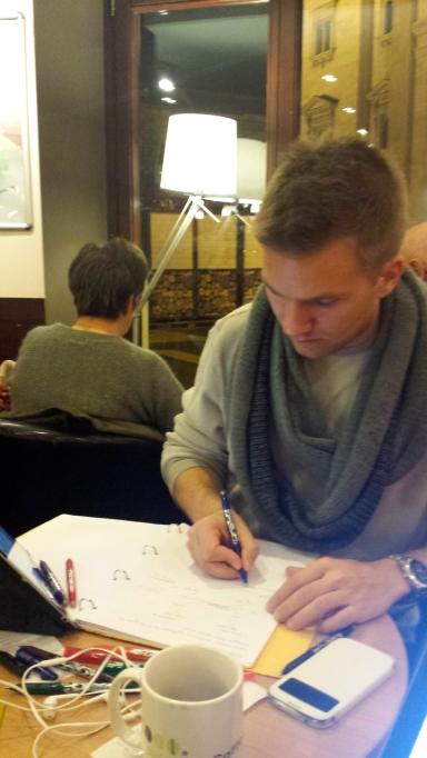 Skjalg studying at a café near the Basilica.